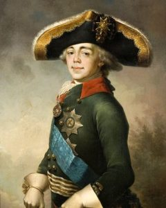 A young man in military uniform with a big hat