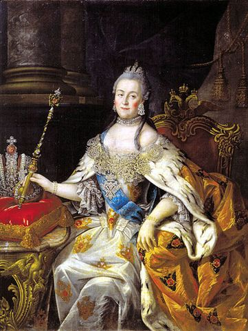 A woman in full royal regalia sitting down. She holds a scepter in one hand.