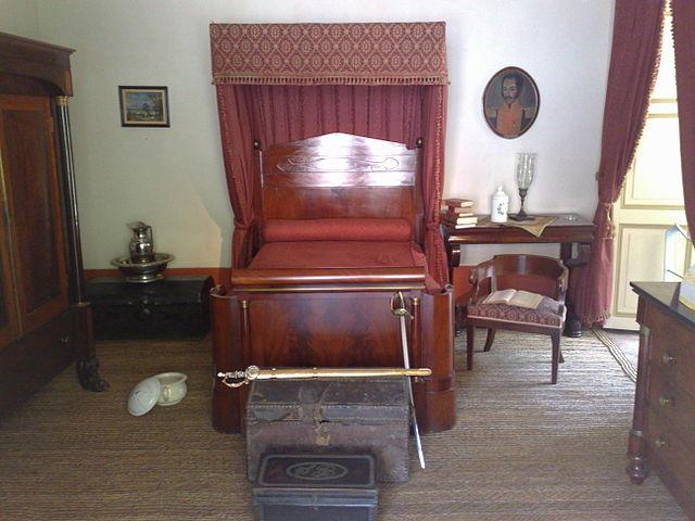 A room with a mahogany bed