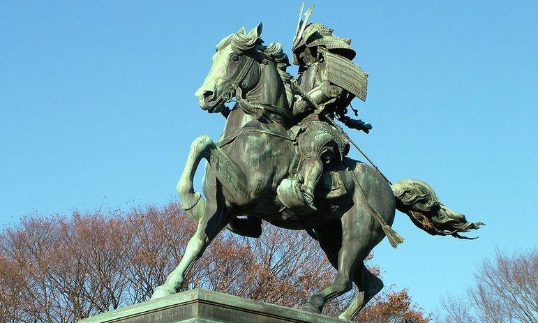 Photo outdoors. Equestrian statue in bronze.