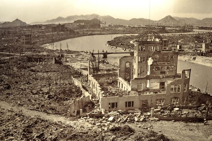 A city razed to the ground, only half a building remains standing.