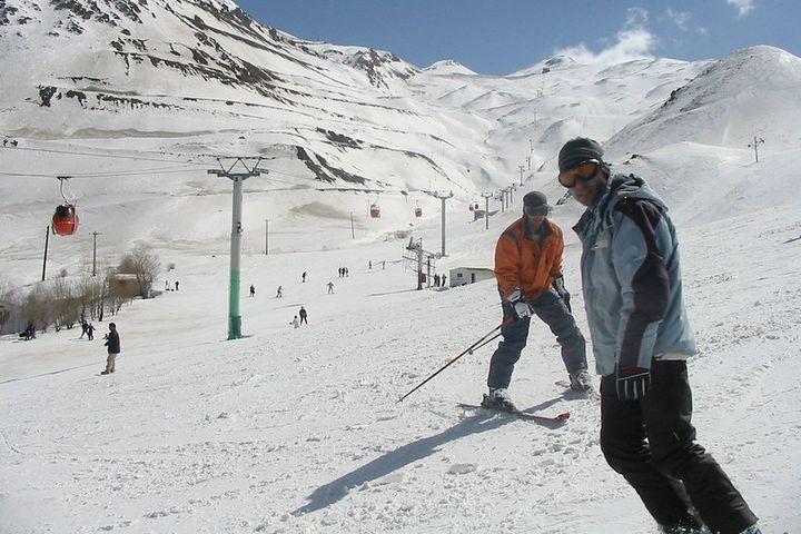 Two boys skiing.