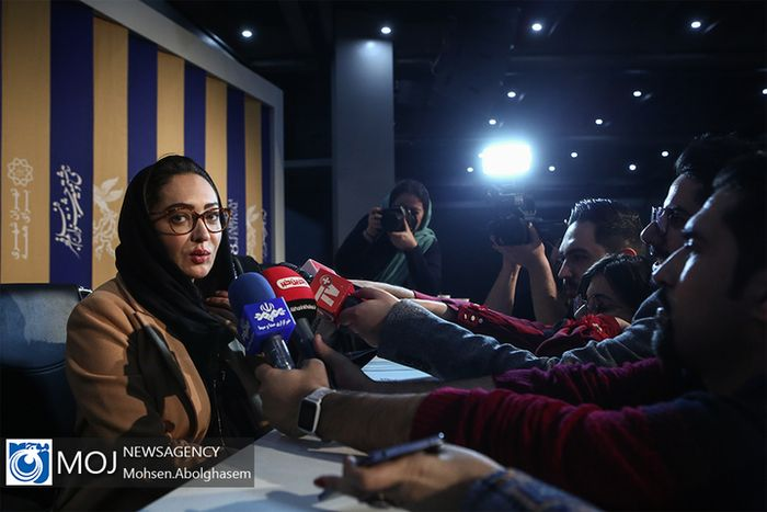 A woman at a press conference.