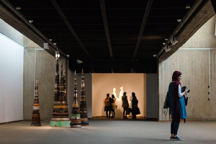 Inside a vast modern-looking museum.