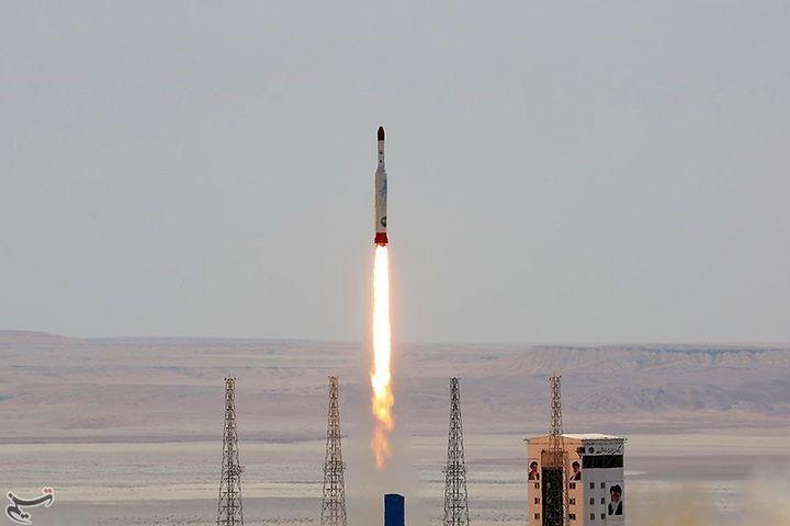 A rocket launching towards space.