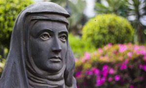 Bronze statue of a nun.