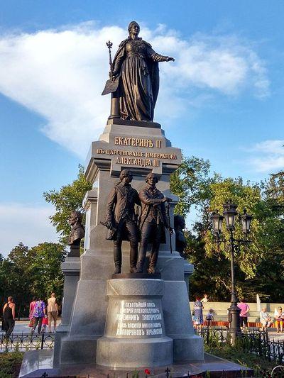 Bronze statue in a park.