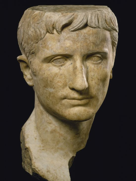 A different marble, a yellowish one. Longish, thin face. Same features. Once again, when seen from the front, the nose is slightly bent to one side.