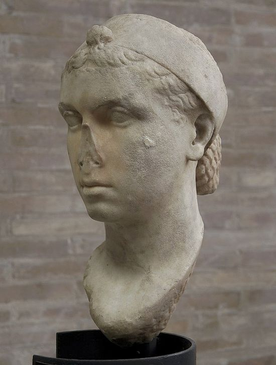 Same bust from another angle. She wears her hair back, in a chignon.