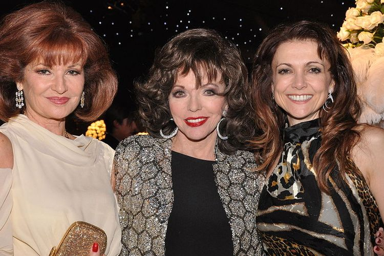 Photo of Joan Collins with two friends at an event.